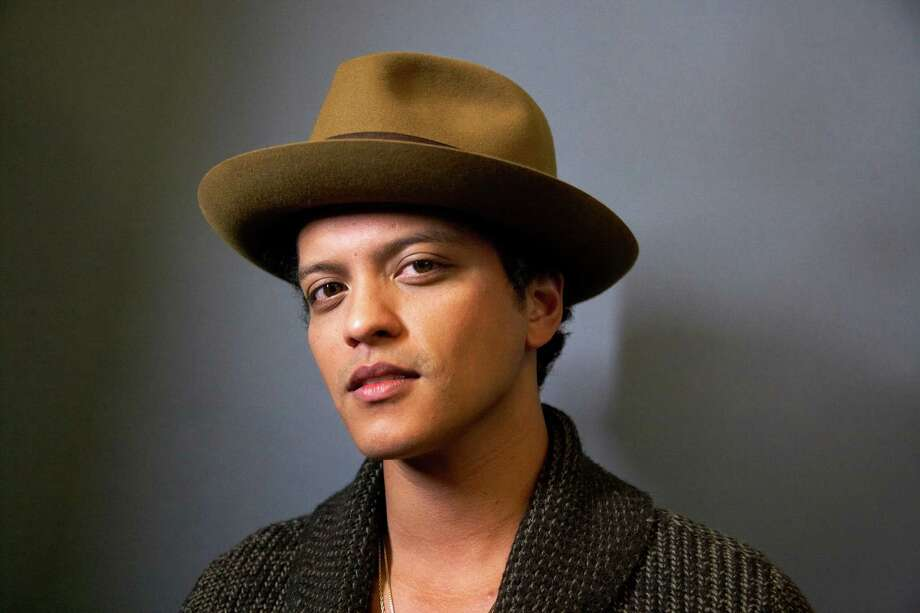 "American singer-songwriter and record producer Bruno Mars, born Peter Gene Hernandez, poses for a portrait on Monday, Nov. 5, 2012 in New York. Mars' recent appearance on ""Saturday Night Live"" was more like Saturday Night Fever: He says he had so much fun hosting the show that he'd be happy to do it again. ""Whatever 'SNL' wants from me, they can always call me,"" the smiling 27-year-old said in an interview Wednesday afternoon. ""I don't know who told them I can act or anything 'cause I can't. I don't know what they saw. (But) whatever they need from me, they can get.""  (Photo by Dan Hallman/Invision/AP) Photo: Dan Hallman"