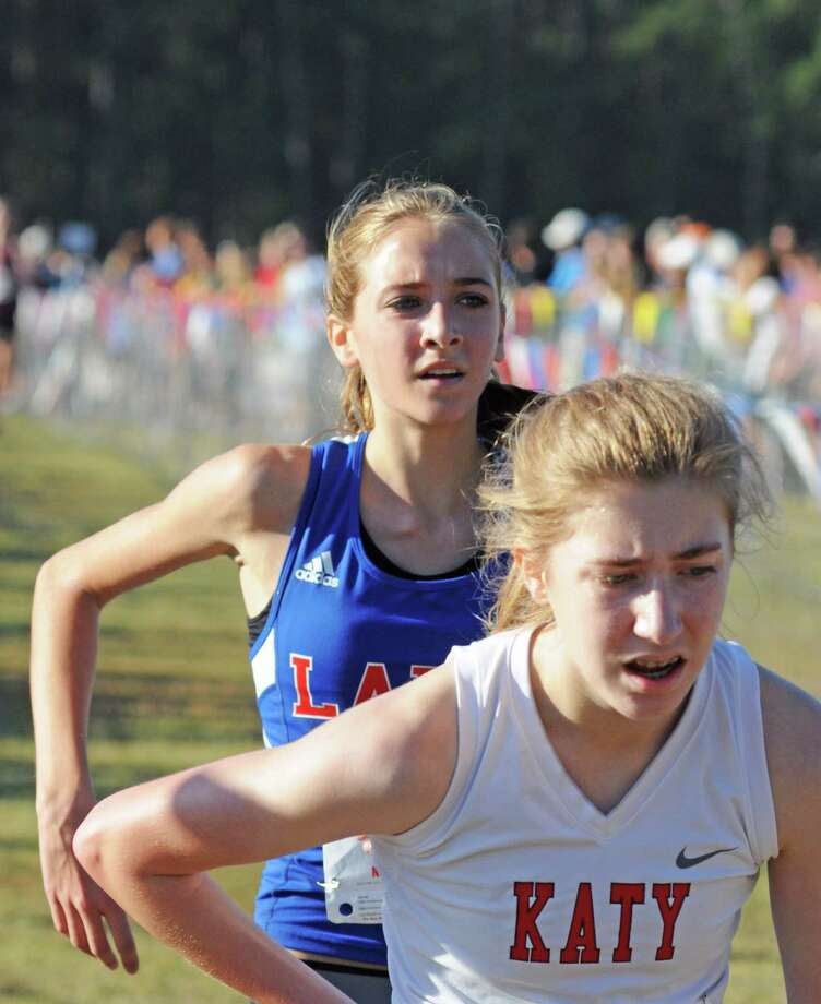 Clear Lake freshman Kate Halloran, back, helped the Lady Falcons place sixth in Region III Class 5A girls cross country meet at Atascocita High School. Photo: L. Scott Hainline / Chronicle