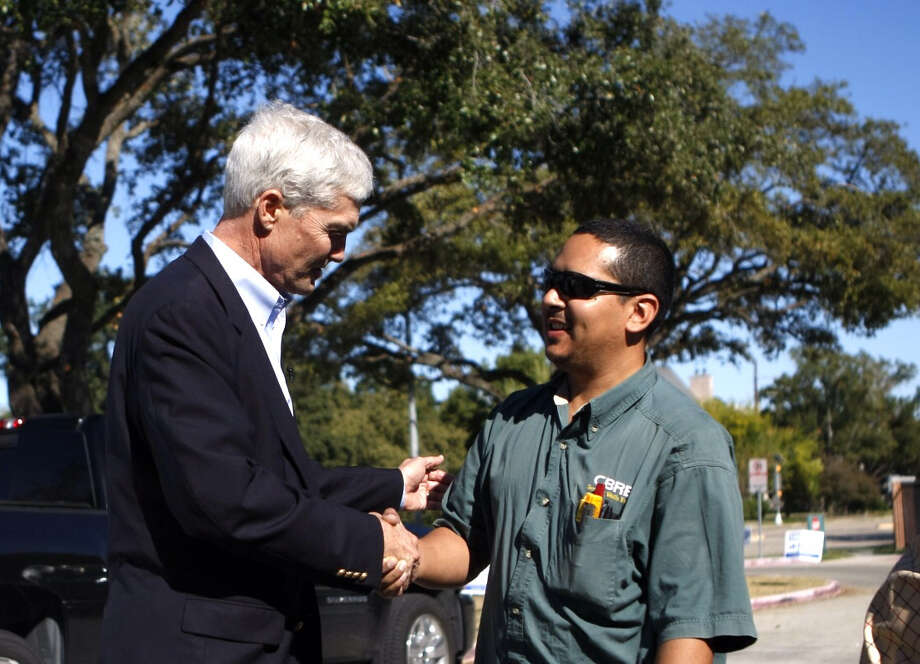 Republican nominee for Harris County District Attorney Mike Anderson greets voter Brian Cuellar outside of a voting location at Briargrove Elementary School. Anderson opposes Democrat Lloyd Oliver. Photo: Johnny Hanson, .
