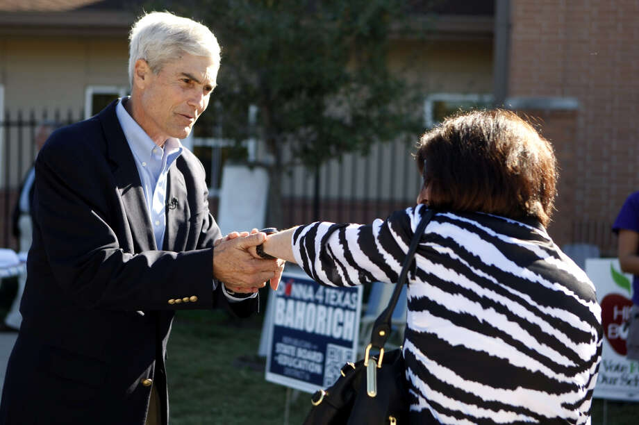 Republican nominee for Harris County District Attorney Mike Anderson greets voter Jinx Chiles outside of a voting location at Briargrove Elementary School. Anderson opposes Democrat Lloyd Oliver. Photo: Johnny Hanson, .