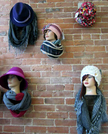 Stylish hats on display at Joe's Salon and Spa on Bank Street in the New Milford village center. November 2012 Photo: Norm Cummings