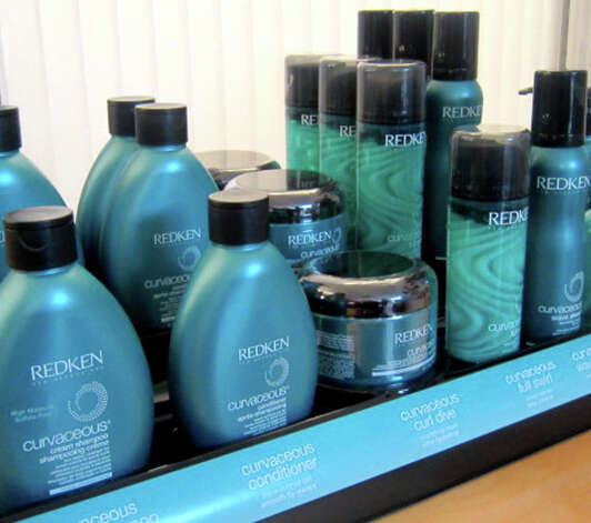 Redken curl products are among those utilized by stylists at Joe's Salon and Spa along Bank Street in the New Milford village center. November 2012 Photo: Norm Cummings