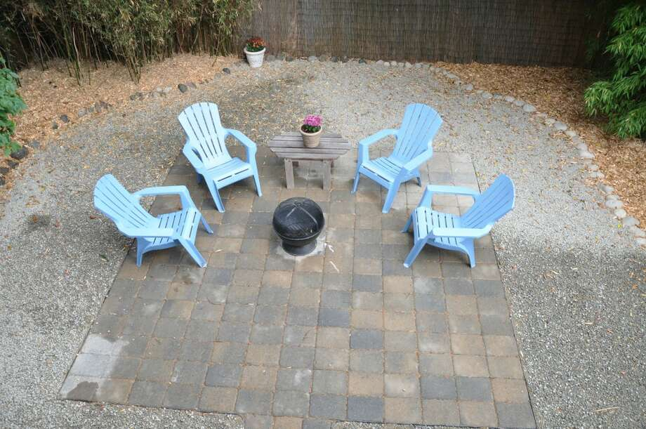 Patio of 3411 42nd Ave. S.W. The 2,500-square-foot house, built in 1914, has four bedrooms, including a unique loft with a vaulted ceiling, two bathrooms, a lower-level rec room and a deck on a 5,000-square-foot lot. It's listed for $479,000. Photo: Courtesy Tanya Edwards/Prudential Northwest Realty Associates