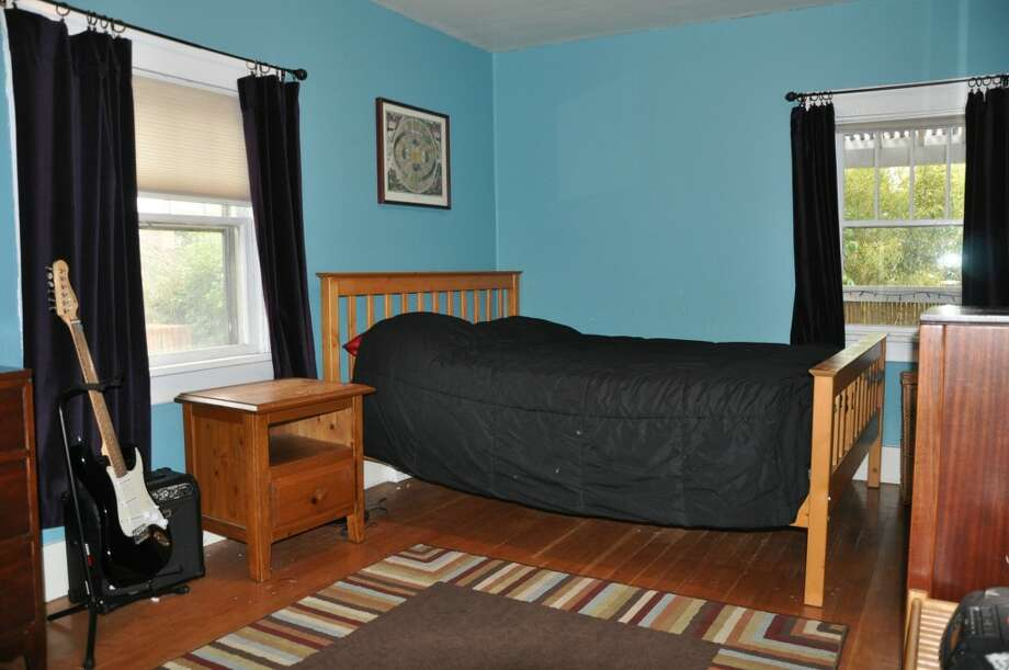 Bedroom of 3411 42nd Ave. S.W. The 2,500-square-foot house, built in 1914, has four bedrooms, including a unique loft with a vaulted ceiling, two bathrooms, a lower-level rec room, a deck and a patio on a 5,000-square-foot lot. It's listed for $479,000. Photo: Courtesy Tanya Edwards/Prudential Northwest Realty Associates