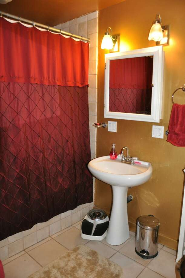 Bathroom of 3411 42nd Ave. S.W. The 2,500-square-foot house, built in 1914, has four bedrooms, including a unique loft with a vaulted ceiling, two bathrooms, a lower-level rec room, a deck and a patio on a 5,000-square-foot lot. It's listed for $479,000. Photo: Courtesy Tanya Edwards/Prudential Northwest Realty Associates