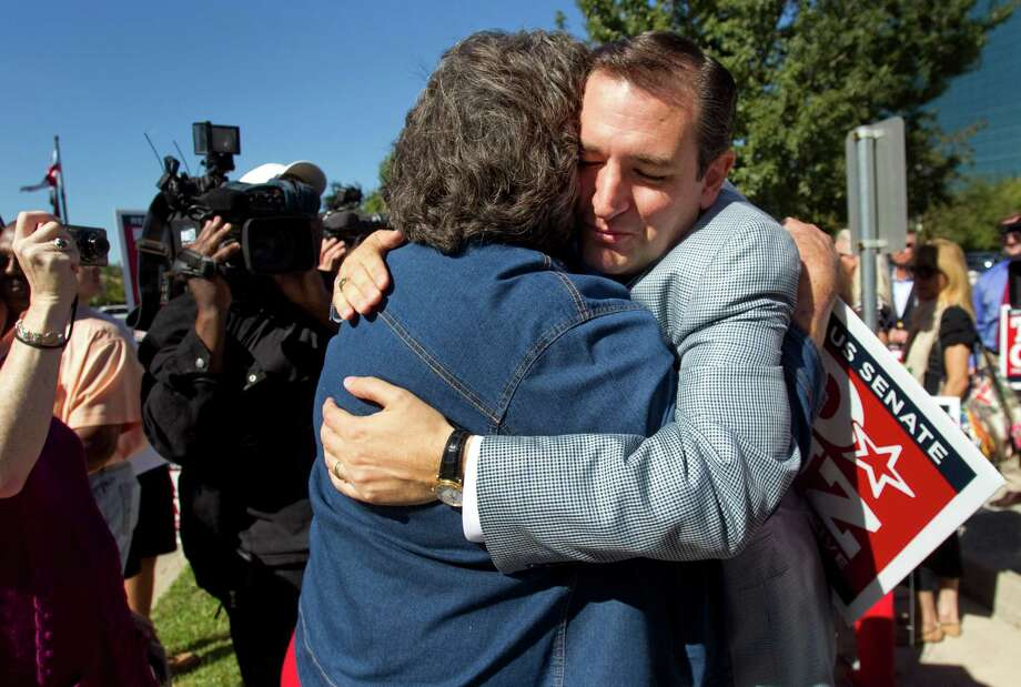 Ted Cruz, Republican candidate for U.S. Senate, embraces supporter Maggie Wright during a campaign stop outside St. Martin's Episcopal Church Tuesday, Nov. 6, 2012, in Houston. Photo: Brett Coomer, . / © 2012 Houston Chronicle