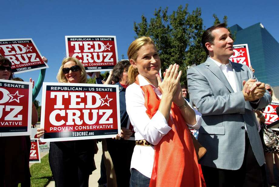 Ted Cruz, Republican candidate for U.S. Senate, right, stands with his wife, Heidi, as he speaks to supporters during a campaign stop outside St. Martin's Episcopal Church Tuesday, Nov. 6, 2012, in Houston. Photo: Brett Coomer, . / © 2012 Houston Chronicle