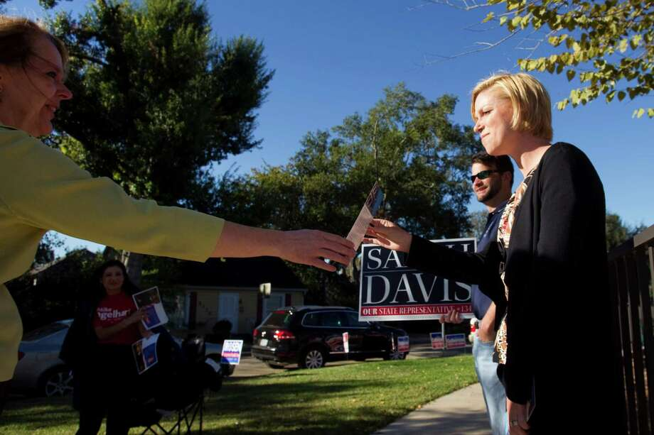 Sarah Davis, Republican candidate running for re-election in the Texas House, campaigns near her home precinct at the Colonial Park Recreation Center on Tuesday, Nov. 6, 2012, in West University Place. Photo: Brett Coomer, . / © 2012 Houston Chronicle
