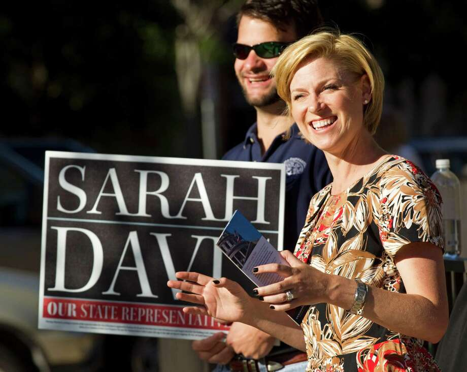 Sarah Davis, Republican candidate running for re-election in the Texas House, stands with Hunter Hughes, as she campaigns near her home precinct at the Colonial Park Recreation Center on Tuesday, Nov. 6, 2012, in West University Place. Photo: Brett Coomer, . / © 2012 Houston Chronicle