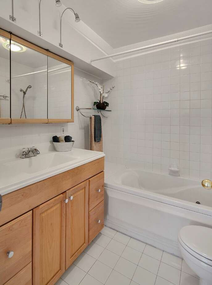 Bathroom of 3601 33rd Ave. S.W. The 2,100-square-foot house, built in 1958, has three bedrooms and two bathrooms, including a lower-level apartment with a second kitchen, walls of windows and a deck on a 3,865-square-foot lot. It's listed for $495,000. Photo: Courtesy Stephanie Kristen/Windermere Real Estate