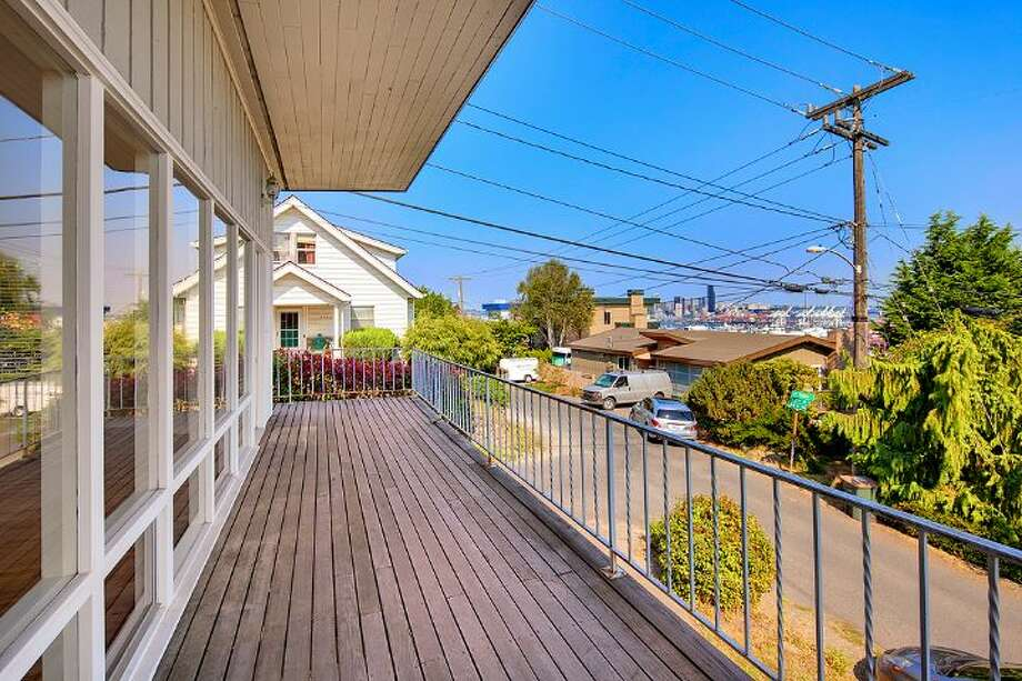 Deck of 3601 33rd Ave. S.W. The 2,100-square-foot house, built in 1958, has three bedrooms and two bathrooms, including a lower-level apartment with a second kitchen, and walls of windows on a 3,865-square-foot lot. It's listed for $495,000. Photo: Courtesy Stephanie Kristen/Windermere Real Estate