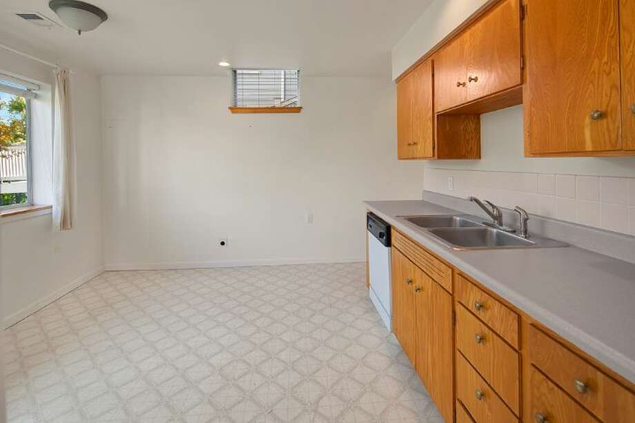 Downstairs kitchen of 3601 33rd Ave. S.W. The 2,100-square-foot house, built in 1958, has three bedrooms, two bathrooms, walls of windows and a deck on a 3,865-square-foot lot. It's listed for $495,000. Photo: Courtesy Stephanie Kristen/Windermere Real Estate