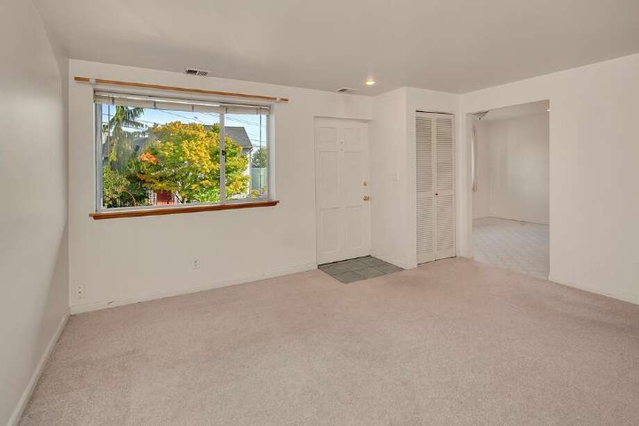 Downstairs apartment of 3601 33rd Ave. S.W. The 2,100-square-foot house, built in 1958, has three bedrooms, two bathrooms, walls of windows and a deck on a 3,865-square-foot lot. It's listed for $495,000. Photo: Courtesy Stephanie Kristen/Windermere Real Estate