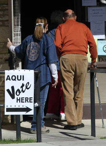 A voter (right) enters the Kenwood Community Center election day Tuesday November 6, 2012. The polls close at 7:00 p.m. . Photo: JOHN DAVENPORT, San Antonio Express-News / ©San Antonio Express-News/Photo Can Be Sold to the Public