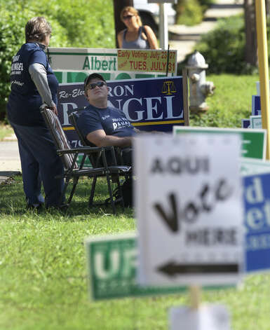 William Davidson (seated) and Sandra Due (left) show their support for judicial candidate Ron Rangel in front of the poll at Lamar Elementary School Tueday November 6, 2012. Photo: JOHN DAVENPORT, San Antonio Express-News / San Antonio Express-News