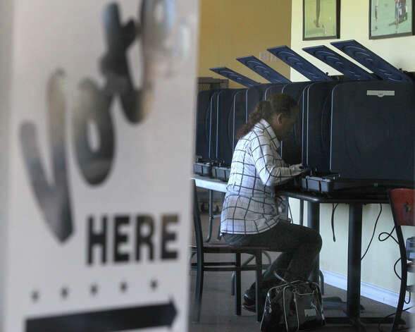 Fres Cortez votes at the Olmos Basin Golf Course Election Day Tuesday November 6, 2012. The polls close at 7:00 p.m. . Photo: JOHN DAVENPORT, San Antonio Express-News / ©San Antonio Express-News/Photo Can Be Sold to the Public