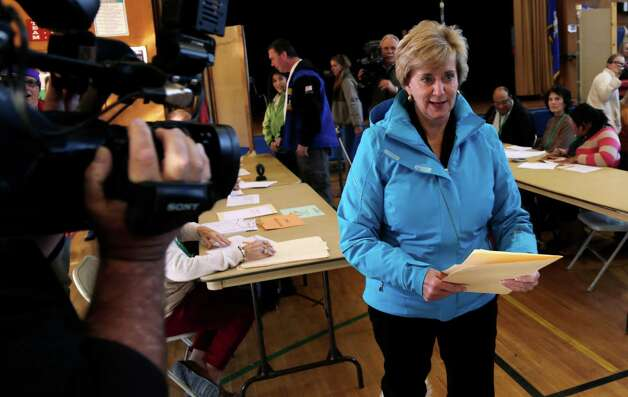 Republican candidate for U.S. Senate Linda McMahon walks with her ballot in hand while voting in Greenwich, Conn., Tuesday, Nov. 6, 2012. McMahon and Democratic opponent Chris Murphy are vying for the Senate seat now held by Joe Lieberman, an independent who's retiring. Photo: Charles Krupa, AP Photo/Charles Krupa / Associated Press