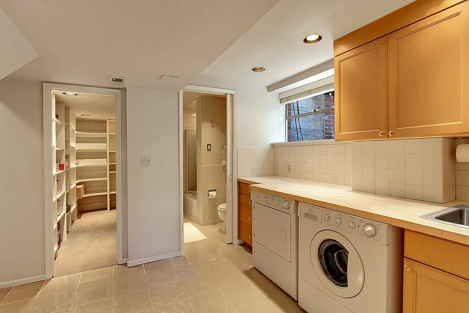 Laundry room of 5052 S.W. Stevens St. The 2,160-square-foot house, built in 1951, has four bedrooms, 1.75 bathrooms, a rec room and a patio on a 5,360-square-foot lot. It's listed for $495,000. Photo: Courtesy Randie Stone/Windermere Real Estate