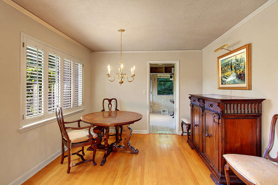 Dining room of 5052 S.W. Stevens St. The 2,160-square-foot house, built in 1951, has four bedrooms, 1.75 bathrooms, a rec room and a patio on a 5,360-square-foot lot. It's listed for $495,000. Photo: Courtesy Randie Stone/Windermere Real Estate