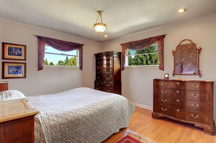 Bedroom of 5052 S.W. Stevens St. The 2,160-square-foot house, built in 1951, has four bedrooms, 1.75 bathrooms, a rec room and a patio on a 5,360-square-foot lot. It's listed for $495,000. Photo: Courtesy Randie Stone/Windermere Real Estate