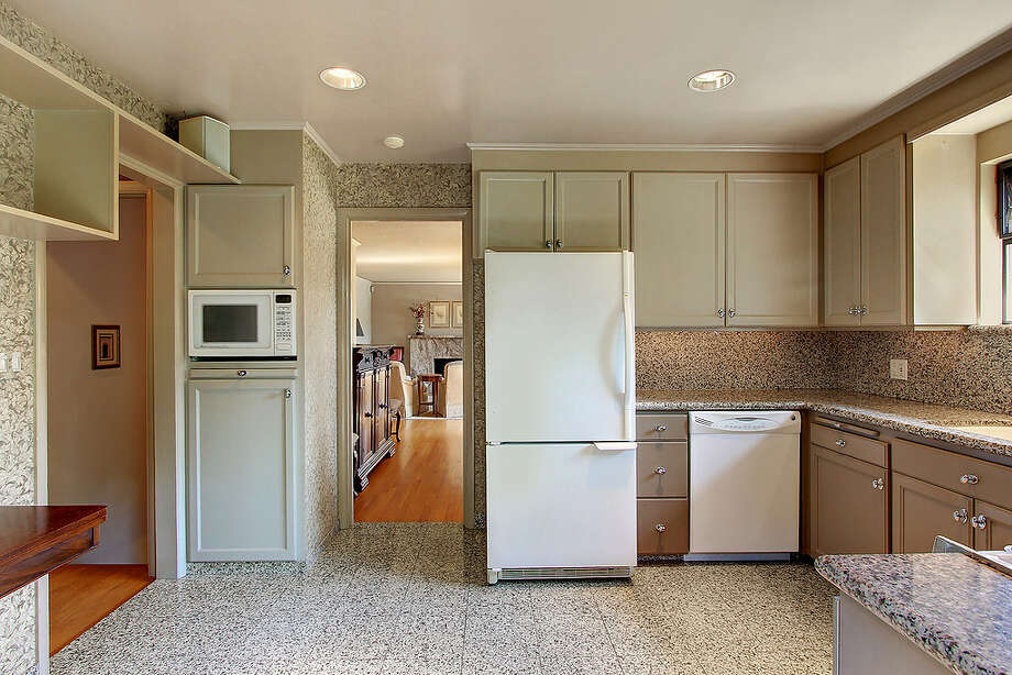 Kitchen of 5052 S.W. Stevens St. The 2,160-square-foot house, built in 1951, has four bedrooms, 1.75 bathrooms, a rec room and a patio on a 5,360-square-foot lot. It's listed for $495,000. Photo: Courtesy Randie Stone/Windermere Real Estate