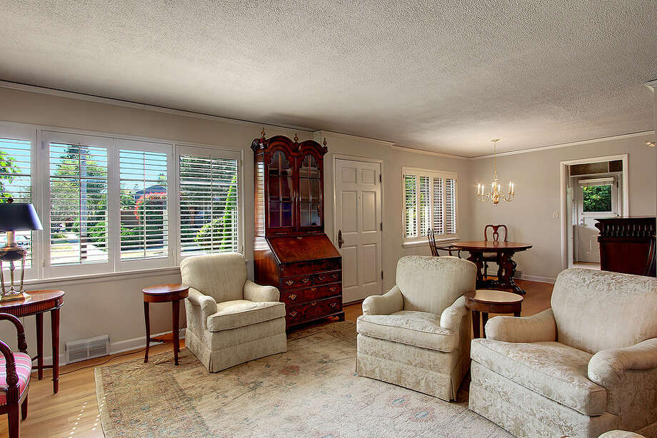 Living room of 5052 S.W. Stevens St. The 2,160-square-foot house, built in 1951, has four bedrooms, 1.75 bathrooms, a rec room and a patio on a 5,360-square-foot lot. It's listed for $495,000. Photo: Courtesy Randie Stone/Windermere Real Estate