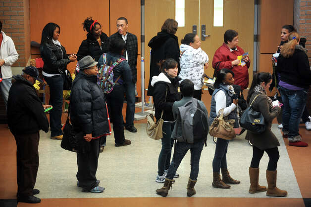 People wait in line to vote at Cesar Batalla School, in Bridgeport, Conn. on Election Day, Nov. 6th, 2012. Photo: Ned Gerard / Connecticut Post