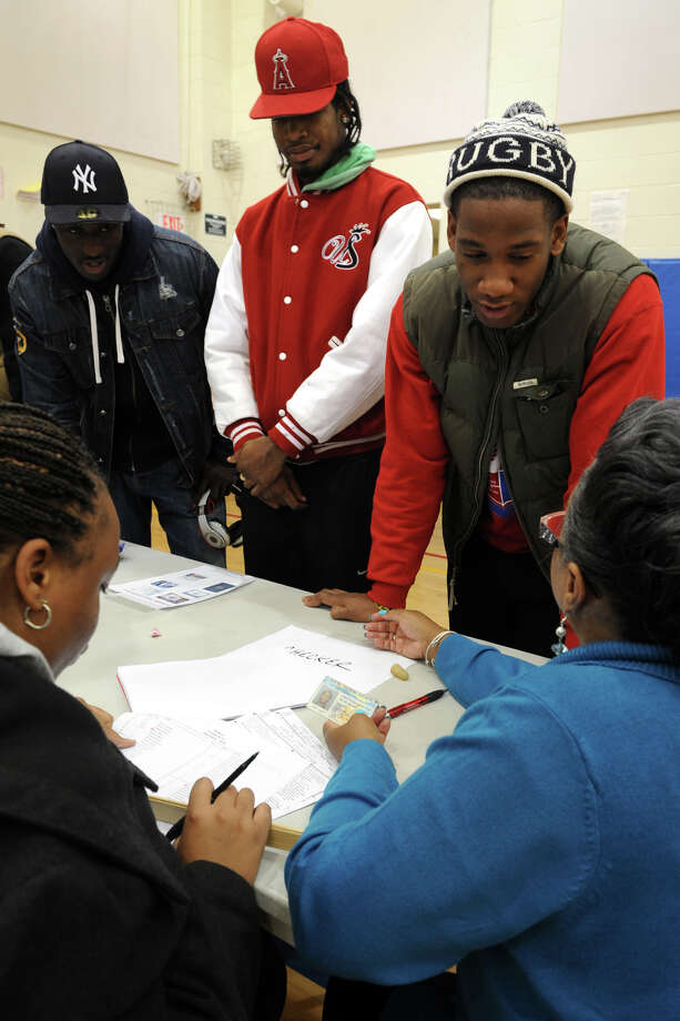 Voting at Cesar Batalla School, in Bridgeport, Conn. on Election Day, Nov. 6th, 2012. Photo: Ned Gerard / Connecticut Post
