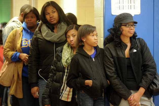 Peolple wait in line to vote at Cesar Batalla School, in Bridgeport, Conn. on Election Day, Nov. 6th, 2012. Photo: Ned Gerard / Connecticut Post