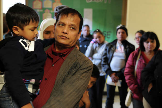 Mohammed Islam waits to vote with his 3-year old son Shaham at Cesar Batalla School, in Bridgeport, Conn. on Election Day, Nov. 6th, 2012. Photo: Ned Gerard / Connecticut Post