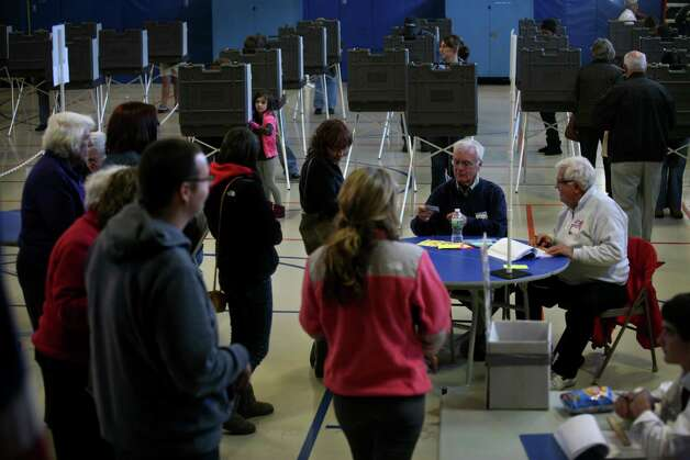 A line forms for voting at Harborside Middle School in Millford in what officials said was a heavy turnout on Tuesday, November 6, 2012. Photo: Brian A. Pounds / Connecticut Post