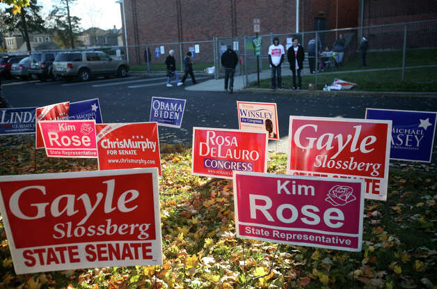 A field of lawn signs greets voters at Harborside Middle School in Millford on Tuesday, November 6, 2012. Photo: Brian A. Pounds / Connecticut Post