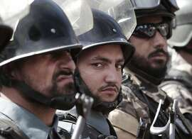 Afghan soldiers stand to attention during the third phase of a transfer of an authority ceremony from the NATO- led troops to Afghan security forces in Kunar province, east of Kabul, Afghanistan, Wednesday, Oct. 10, 2012. The security responsibilities of three districts including the provincial capital of Kunar province was handed over from the NATO- led forces to Afghan security forces. The process of taking over security from NATO-led ISAF forces by Afghan troops would be completed by the end of 2014 when Afghanistan will take over the full leadership of its own security duties from U.S. and NATO forces. (AP Photo/Rahmat Gul)