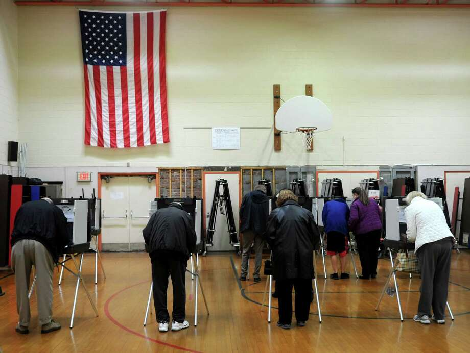 Voters fill in their ballots at Roxbury Elementary School on Tuesday, November 6, 2012. Photo: Lindsay Niegelberg / Stamford Advocate