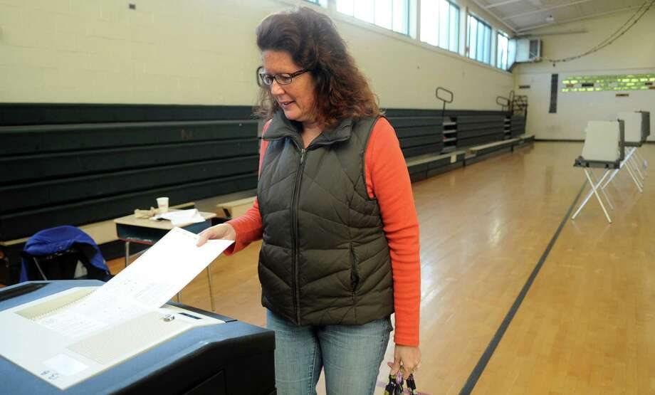 Julia Burke submits her ballot at Rippowam Middle School on Tuesday, November 6, 2012. Photo: Lindsay Niegelberg / Stamford Advocate