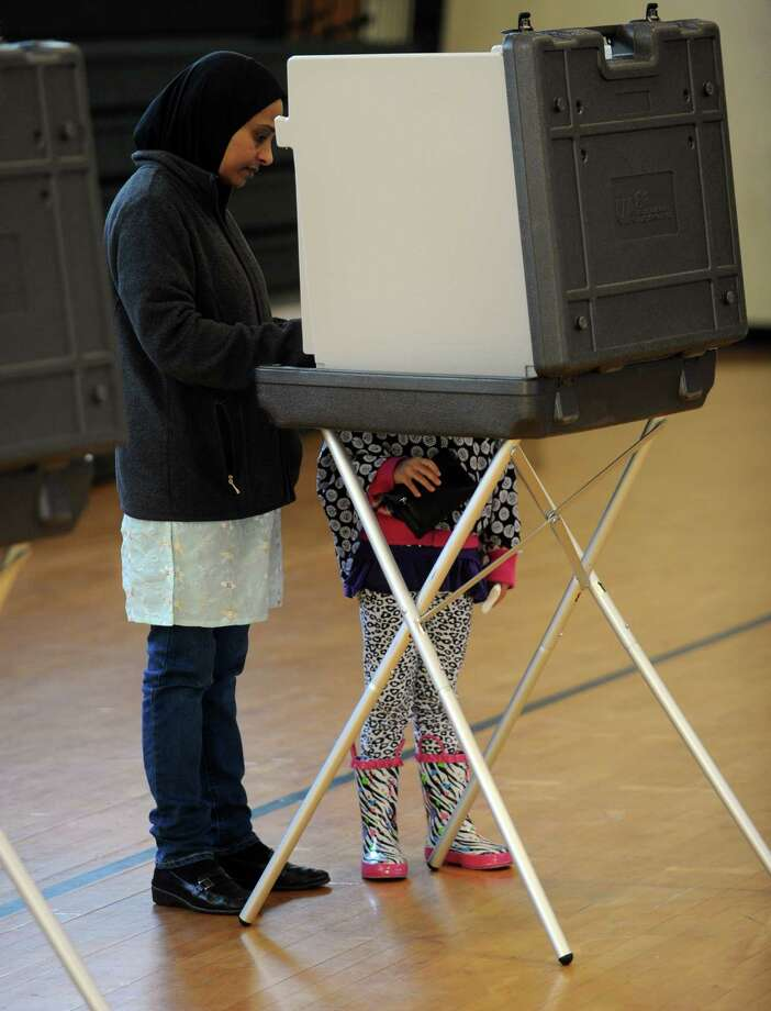 Abeda Jamsu and her daughter, Falak, 6, vote at Rippowam Middle School on Tuesday, November 6, 2012. Photo: Lindsay Niegelberg / Stamford Advocate