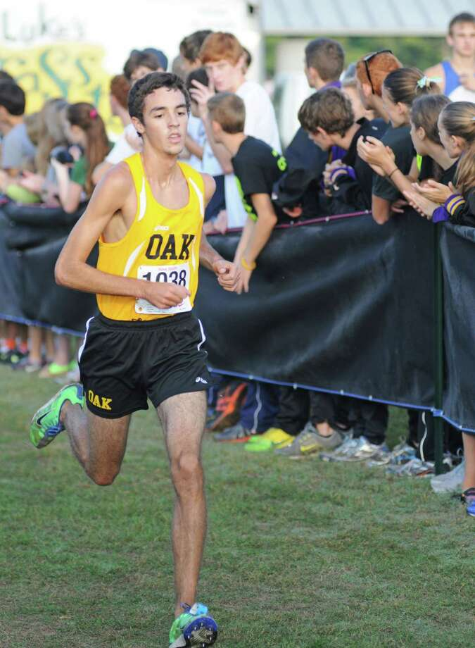 The Klein Oak boys cross country team placed second in District 13-5A to earn a 2012 regionl berth, and the Panthers were led by 13-5A individual gold medalist Bradley Dohner (1038). Photo: L. Scott Hainline / The Chronicle