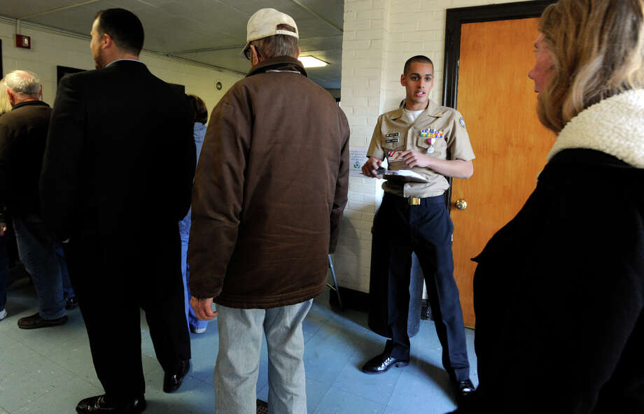Nigel Wasti, with the Bethel ROTC, directs voters as they arrive at the Bethel Municipal Center to vote on Election Day, Tuesday, Nov. 6, 2012. Photo: Carol Kaliff / The News-Times