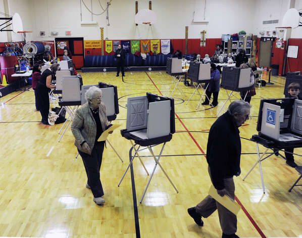 Voting in the gymnasium at New Lebanon School in Byram, Tuesday afternoon, November 6, 2012. Photo: Bob Luckey / Greenwich Time
