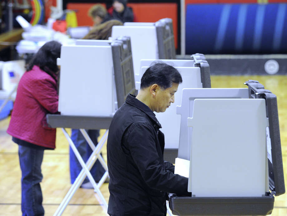 Jin Han votes at New Lebanon School in Byram, Tuesday afternoon, November 6, 2012. Photo: Bob Luckey / Greenwich Time