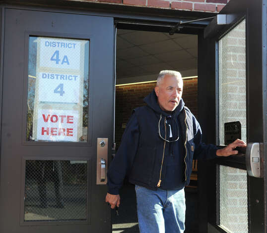 Anthony Micheletti leaves the district 4A and 4 polling place after voting in the election at New Lebanon School in Byram, Tuesday afternoon, November 6, 2012. Photo: Bob Luckey / Greenwich Time
