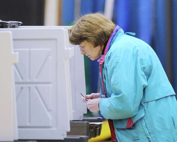 Carmela Strazza votes at Western Middle School in Byram, Tuesday afternoon, November 6, 2012. Photo: Bob Luckey / Greenwich Time