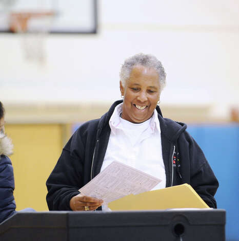 Kathy Robinson smiles before entering her ballot into the voting tabulation machine at Western Middle School in Byram, Tuesday afternoon, November 6, 2012. Photo: Bob Luckey / Greenwich Time