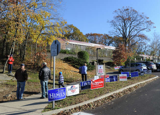 Political signs line the entrance to New Lebanon School in Byram, Tuesday afternoon, November 6, 2012, on election day. Photo: Bob Luckey / Greenwich Time