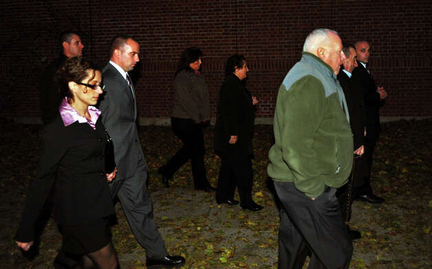 Jason Anderson, walking at left, leaves Milford Superior Court with his family after the judge in his case threw out the verdict in downtown Milford, Conn. on Tuesday November 6, 2012. Photo: Christian Abraham / Connecticut Post