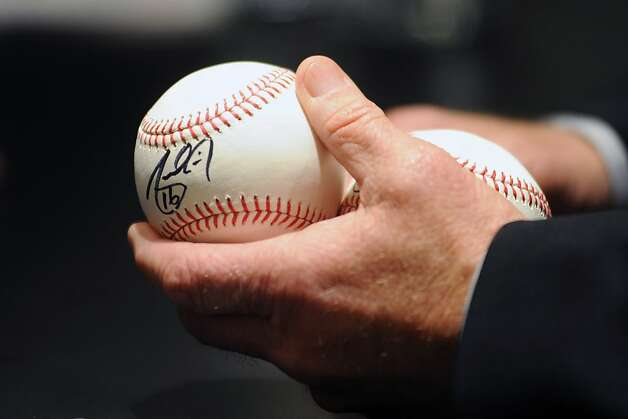 longtime Giants fan Drina Lizarraga of San Francisco; balls signed by Pagan. Photo: Michael Short, Special To The Chronicle