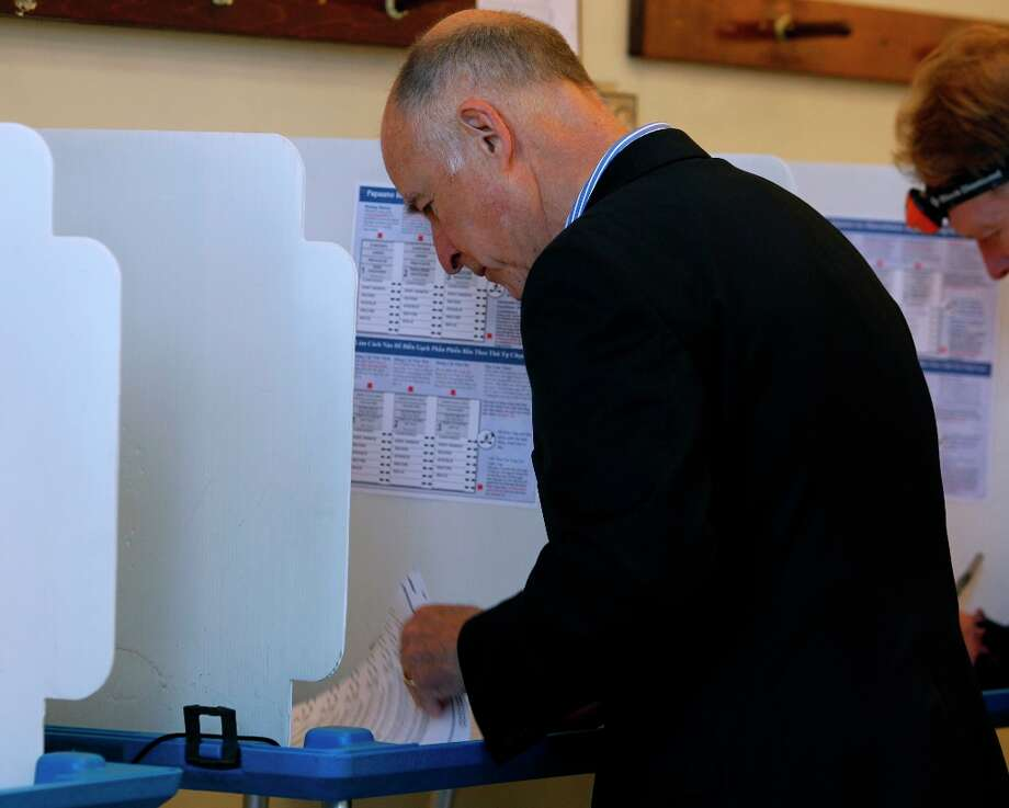 Gov. Jerry Brown votes near his home in Oakland, Calif. on Tuesday, Nov. 6, 2012. Brown later held a news conference to discuss the Prop. 30 school tax intiative on the ballot. Photo: Paul Chinn, The Chronicle / ONLINE_YES