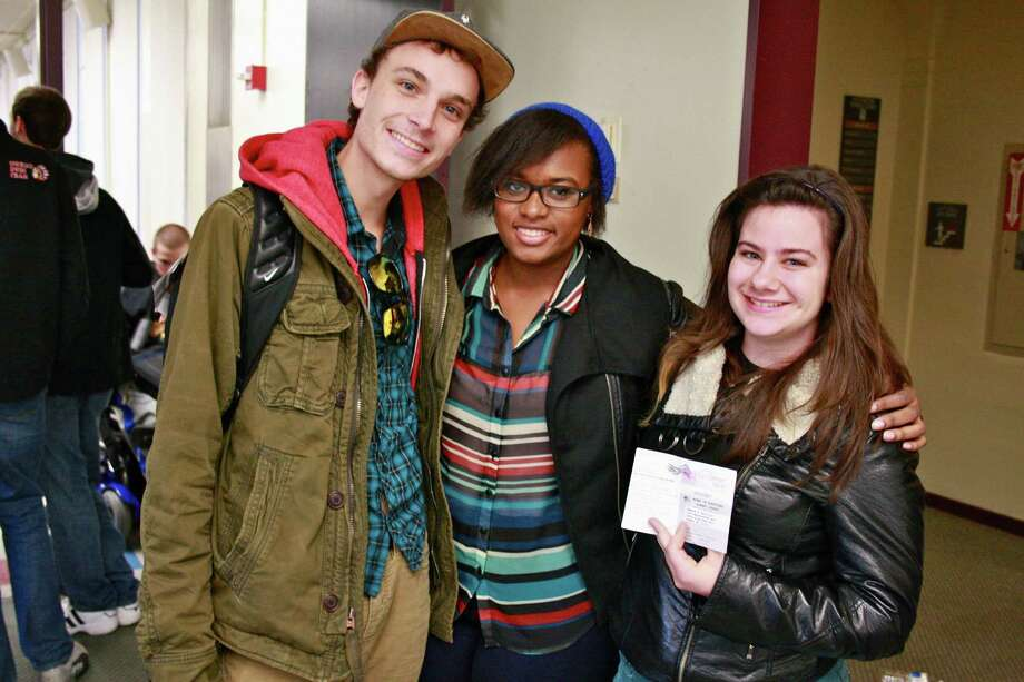 First time voters Partick Lewis, Erica-Ashley Gins and Teresa Castillo at UAlbany, where a massive voter turnout prompted long lines outside the campus polling station. (Kristen V. Brown/Times Union)