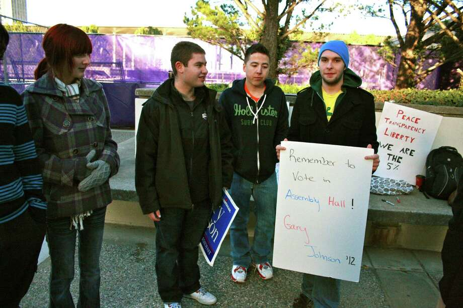 Libertarian UAlbany students campaign for Gary Johnson outside the campus polling station. (Kristen V. Brown/Times Union)