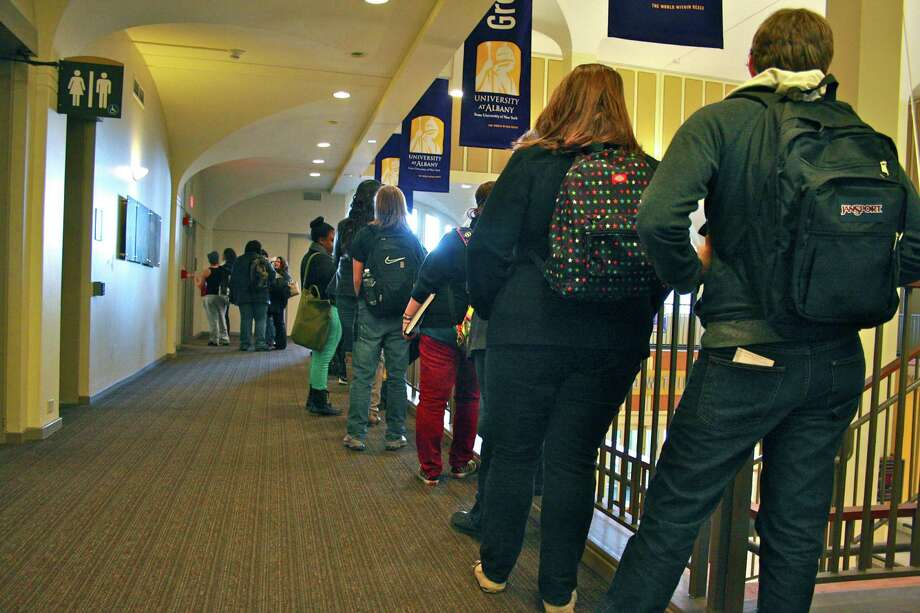 At UAlbany, a massive voter turnout prompted long lines outside the campus polling station. (Kristen V. Brown/Times Union)